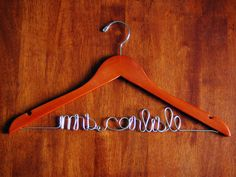 Customized wire name hanger for my dress + my love's suit.