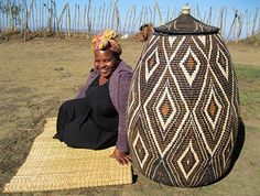 Pictured here is Mbali Sibiya, one of the master weavers along with one of her amazing baskets. | www.africaandbeyond.com The Zulu Baskets we sell are a fair trade project that support women in South Africa.