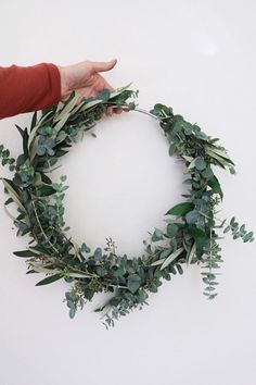 A modern 12 floral hoop wreath - very popular in weddings and home decor trends lately. The standard metal finish is silver. If you would like gold, we will have to have 3-4 additional business days to special order this in for you. Please note that in some of these photos the pictured hoop is an 8