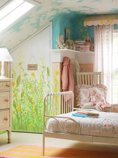 Pink room with garden painted walls and sky on ceiling