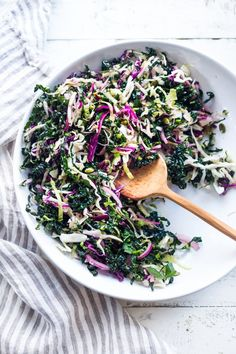This Everyday Kale Slaw with Lemon Dressing can be made ahead, then used DAILY to top off tacos, buddha bowls, burgers, even pizza! Vegan and Gluten Free!   www.feastingathome.com