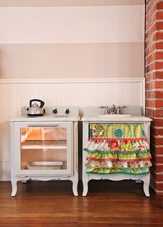 LOVE the fabric choice, and LOVE the idea of refurbishing old nightstands as  a child-sized play kitchen...
