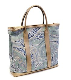 Our blue paisley pattern tote bags craftspeople is lined with woven silk and marked with the Marlborough World logo to confirm its authenticity. The bag is finished in a Smooth Gold Leather giving you that luxurious feel.