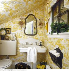 BATHROOMS: Under stairs room, French style, upholstered pale yellow and white toile scene, white vintage pedestal sink, crystal and glass sconces, swag valance, leaded glass window, black accents with yellow and white.