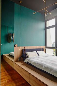 House Tour: A minimalist, Nordic-style two-bedroom condo apartment with green and blue shades