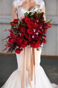 This bountiful bridal bouquet is entirely composed of flowers in shades of red. This way you get the benefit of different textures and shapes while maintaining a harmonious unity. | Gorgeous Red Wedding Bouquets
