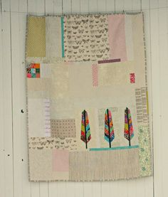 Blue Elephant Stitches: Feather Quilt Holy shit this is amazing. I love that she thought out of the box with this. I'm currently working on a feather quilt (with just feathers) and this just is so much more dynamic!