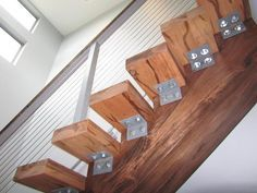 Mono-stringer stairs using all wood, with stainless steel cable railing.