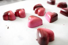 Chocolate Secrets hand painted, raspberry bonbon. #ChocolateSecrets #Bonbon #Raspberry #Dessert #Delicious #SoGood