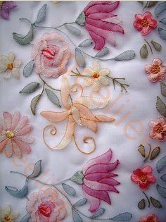 100 by deelliiee, via Flickr  Almost any hand embroidery design can be combined with shadow work.  The work on the right side looks soft and translucent and is usually done on organza