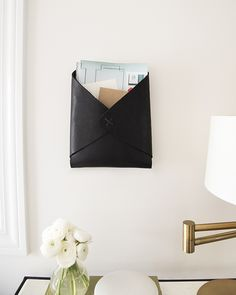 a super simple DIY: Wall-Mounted Leather Catchall | via coco+kelley
