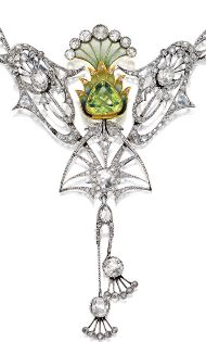 AN ART NOUVEAU PLIQUE-À-JOUR ENAMEL, PERIDOT AND DIAMOND NECKLACE, CIRCA 1900. Centring on a pear-shaped peridot, amid an openwork frame, decorated by plique-à-jour enamel, rose- and old-cut diamonds, completed by a double link-chain spectacle-set with rose-cut diamonds, mounted in 18 carat white and yellow gold, pendant detachable. #ArtNouveauPeridot♥≻★≺♥