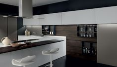 Amazing #designkitchen with exclusive wall accessory rack and wall suspended sliding elements. A Light 31 project. http://www.modulnova.com/project-light-31