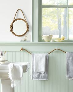 Cute use of decorating with rope.love wainscot, color and brachytherapy nautical theme