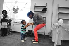"""Life is not about waiting for the storm to pass but learning to dance in the rain."" Child development lead teacher, LaToya Thomas, teaches one of our little ones how to dance at our Valentine's Day dance."