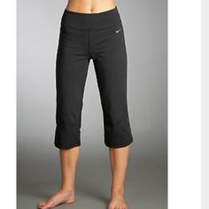 • Nike Yoga Crops • Black nike yoga crops. Flare kind of leg opening. Worn once. Tags have been cut out. Size is medium. Nike Pants Ankle & Cropped