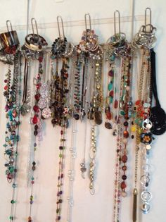 Use over the door holder to hang around 50 necklaces and 50 bracelets. Individually  hook necklaces around the middle section of the holder to allow easy removal of bracelets stacked on top hooks.