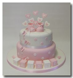 Hearts n booties, butterflies n blocks 2 tier cake