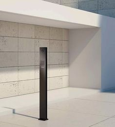 the siedle steel entrance door station in matt black complements the design of this entrance. Black Bedroom Furniture Sets. Home Design Ideas