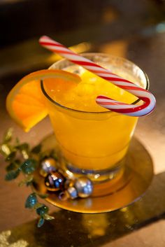 Joyous Noel by Hotel @Hotel Monteleone, via Flickr Recipe created by:  Marvin Allen,  1 oz. Absolut Mandarin, 1 oz. Grand Marnier, 3 oz. Orange Juice, Mix the ingredients in a cold shaker.  Shake well and pour over ice into a chilled glass.  Garnish with a candy cane.
