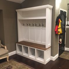 back and single open shelf on top, wooden seat, trim on top and side. I like everything about this one, just add in the other wall Mudroom Cabinets, Mudroom Laundry Room, Entryway Storage, Built In Storage, Entryway Bench, Rustic Farmhouse Table, Farmhouse Furniture, Cube Shelves, Home Upgrades
