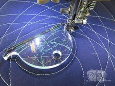 Use rulers to guide free motion quilting on a sewing machine.