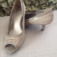 Nude adorable and comfortable shoes! Nude adorable and comfortable shoes! Worn few times overall good condition. Bandolino Shoes