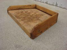 """This is a charming Primitive antique cutting board that dates from 1880. The Primitive antique cutting board is 3.5"""" tall, 19 1/4"""" wide, 12.5"""" deep, and it is in great original condition. $ 100.00"""
