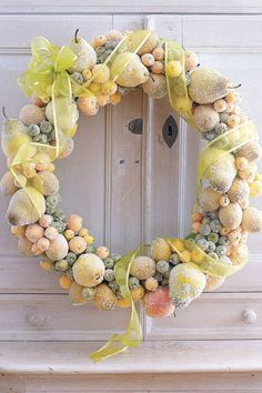 They may look sugar-coated, but Epsom salts and white glitter cover these fake fruits. Loosely wrapped ribbon adds the finishing touch. Click through for the tutorial and more DIY Christmas wreath ideas.