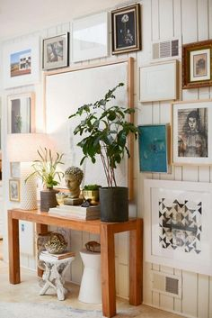 Decorating Ideas for Your Home's 5 Smallest Spaces// Parsons table, gallery wall, indoor plants
