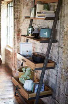 Natural woods and carefully selected accessories are key components of the Scandi Seaside trend. Natural Light, Natural Wood, Boat Accessories, Ladder Bookcase, Coastal Living, Seaside, Woods, Shelves, Key