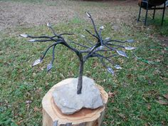 Bonsia tree forged from 3 pieces of crane cable, set in sandstone base.