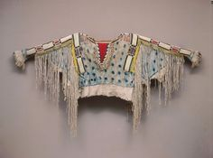 Also from the Diker Collection, a Nez Perce (Oregon) man's shirt, circa 1850, includes hide, porcupine quills, horsehair, wool, glass beads and pigmen...