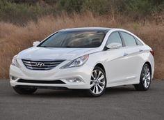 This is my new car. I love it!!  Woodie and I got it last week.  2013 Hyundai Sonata in Shimmering White