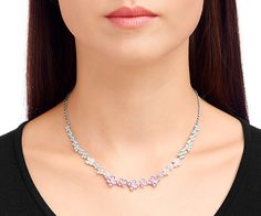 Cherie Necklace - Inspired by an accumulation of mini flowers, the Cherie Necklace sparkles in a feminine gradation of pink crystals. This versatile piece looks great with a casual outfit or on elegant occasions too. The design is very light and easy to wear and the rhodium-plated chain is adjustable.
