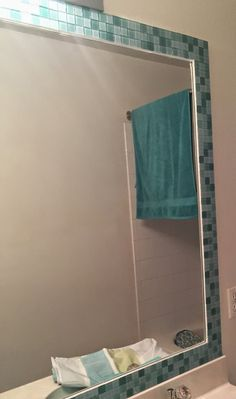 Budget Bathroom Makeover - A no grout tile mirror border.  Easy, and inexpensive!