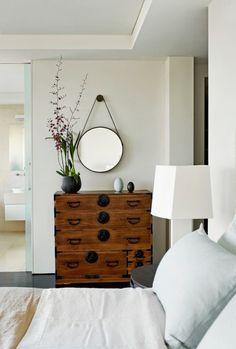 round mirror, industrial chest