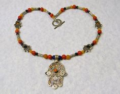 1 1/2 inch Moroccan Tuareg Berber style silver & yellow, blue & red enamel hamsa pendant on necklace of 4 & 6mm lapis, red jade and carnelian rounds with Hill Tribe stamped silver tubes, hamsa bead fr