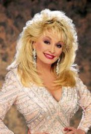 Dolly Parton-she has her own amusement park, she is a spitfire, and a philanthropist.  Gotta love a woman who can fill a costume with her bust area.