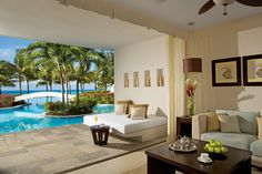 Swim right up to your room with this luxurious suite from Secrets Aura Cozumel.