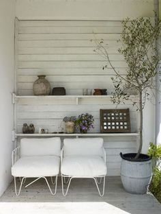 Paint your porch white and add white chairs for a truly beautiful place to enjoy the sun - #DIY #Garden #Ideas