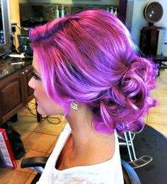 The updo is beautiful and the color is so vibrant!