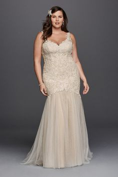 Galina Signature Style 9SWG723 Beaded Venise lace trumpet gown with tank straps, open illusion back with button closure, and tulle skirt. Chapel train.