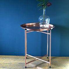 Useful foldable side table in copper.... could be folded away when buggy is in corner