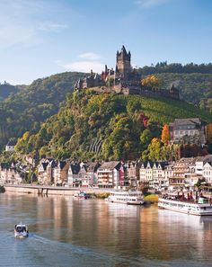 Reichsburg Castle, Cochem, Germany. Yes those are vineyards surrounding the castle!