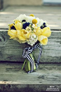 I'm not sure how I feel about the flowers with the navy centers, but I love the yellow flowers and the navy and white ribbon!