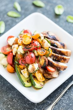 Balsamic Grilled Chicken Topped with Caprese Salad