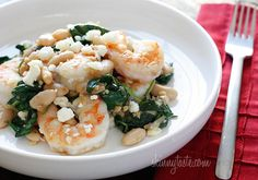 Shrimp, white beans and wilted spinach topped with crumbled feta. Easy and delish!