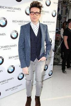 Nick Grimshaw wearing an A.Sauvage jacket, Richard James shirt and John Lobb boots at London Collections Men