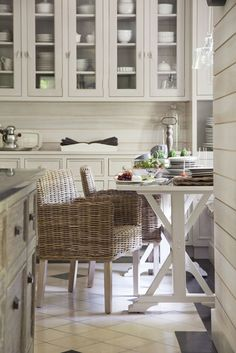 A country home in Beaconsfield, Montreal White and rattan with glass cupboards